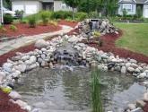 Vandens krioklys su baseinu